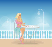 Beautiful woman in cafe Royalty Free Stock Photo