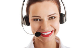 Beautiful woman on call center with microphone and headphones. Stock Photo