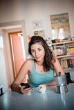 Beautiful woman calling during breakfast Stock Images