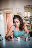 Beautiful woman calling during breakfast Royalty Free Stock Photography