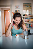 Beautiful woman calling during breakfast Stock Image