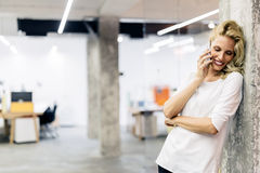 Beautiful woman calling from home Royalty Free Stock Photo