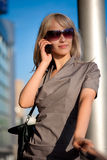 Beautiful woman calling to cellphone. Outdoors Royalty Free Stock Images