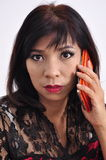 Beautiful woman calls with her smartphone Stock Photos