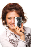 Beautiful woman with a camera. Woman taking a photograph with a classic camera Royalty Free Stock Images
