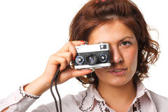 Beautiful woman with a camera. Woman taking a photograph with a classic camera Royalty Free Stock Image