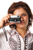Beautiful woman with a camera. Woman taking a photograph with a classic camera Stock Photography