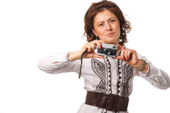 Beautiful woman with a camera. Woman taking a photograph with a classic camera Stock Images