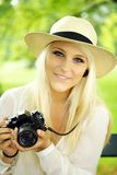 Beautiful woman with camera Royalty Free Stock Photography