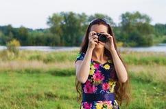 Beautiful woman with camera Stock Photo