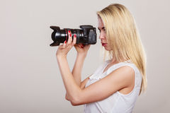 Beautiful woman with camera. Royalty Free Stock Photography