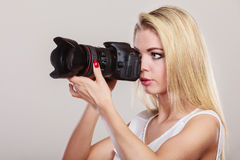 Beautiful woman with camera. Stock Photography