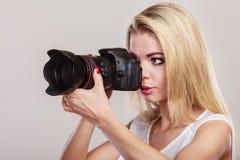 Beautiful woman with camera. Stock Photo