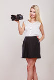 Beautiful woman with camera. Stock Images