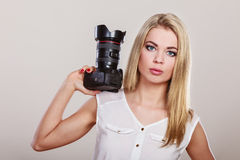 Beautiful woman with camera. Royalty Free Stock Photo