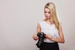 Beautiful woman with camera. Stock Photos