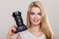 Beautiful woman with camera. Royalty Free Stock Image