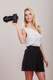 Beautiful woman with camera. Stock Image