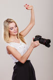 Beautiful woman with camera. Royalty Free Stock Images