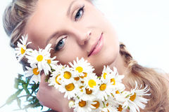Beautiful woman with camomile. Royalty Free Stock Photo