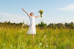Beautiful woman in a camomile field Royalty Free Stock Image