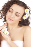 Beautiful woman with camomile flower Royalty Free Stock Photography