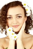 Beautiful woman with camomile flower Stock Photography