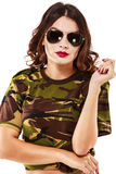 Beautiful woman in camouflage shirt and jeans Stock Photo