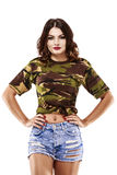 Beautiful woman in camouflage shirt and jeans Stock Photography