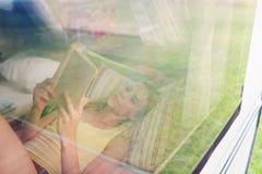 Beautiful woman in a camper van Stock Images