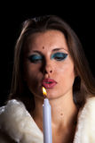 Beautiful woman with candle on black background Royalty Free Stock Photo