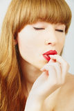 Beautiful woman with a candy Stock Photos