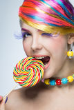 Beautiful woman with candy Stock Photos