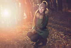 Beautiful woman with cap and gloves in autumn Stock Images