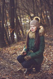 Beautiful woman with cap and gloves in autumn Stock Photos
