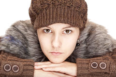 Beautiful woman with cap looks serious Stock Photography