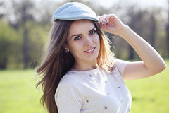 beautiful  woman in a cap Stock Images