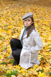 Beautiful woman in cap and white coat Stock Images