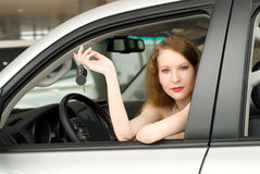 Beautiful woman at the car Royalty Free Stock Image