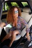 Beautiful woman in car Stock Image