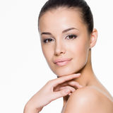 Beautiful woman cares for the face Royalty Free Stock Images