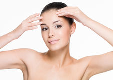 Beautiful woman cares of forehead Royalty Free Stock Photos