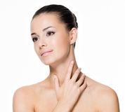 Beautiful woman cares of neck stock images