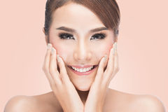 Beautiful woman cares for the skin face, Beautiful Spa Woman Touching her Face Royalty Free Stock Image