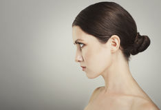 Beautiful woman cares for the skin neck posing at studio isolate Royalty Free Stock Photos