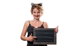 Halloween concept. Woman with carnival cat ears holding chalkboard Stock Photos