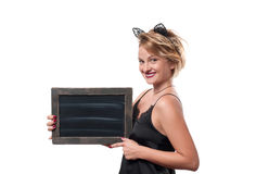 Halloween concept, woman with carnival cat ears holding chalkboard Stock Photography