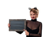 Halloween concept, woman with carnival cat ears holding chalkboard Royalty Free Stock Photography