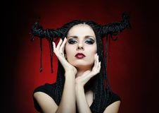 Beautiful woman in carnival costume. witch shape Stock Photo
