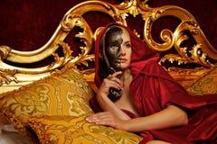 Beautiful woman with a carnival mask Stock Photo